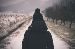 Person in Black Knit Cap About to Walk in Grey Empty Pathway during Daytime Royalty Free Stock Image