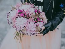 Person in Black Leather Jacket Pink and Red Flower Bouquet Royalty Free Stock Photos