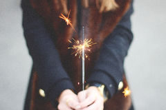 Person in Black Long Sleeve Shirt Holding Gray Sparkler in Selective Photography Royalty Free Stock Image