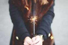 Person in Black Long Sleeve Shirt Holding Gray Sparkler in Selective Photography Stock Photography