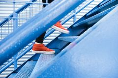 Person in Black Pants and Red High Top Sneakers Walking on Stairs Royalty Free Stock Photo