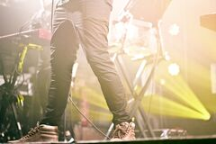 Person in Black Pants on Stage Royalty Free Stock Photo