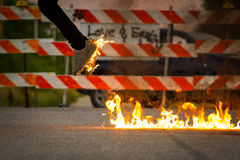 Person in Black Pants Wearing White Shoe Jumping on Fire Royalty Free Stock Photography