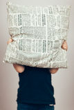 Person in Black Shirt Cover His Face With Newspaper Design Throw Pillow Stock Image