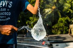 Person in Black Shirt Pouring Water Stock Photography