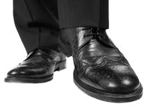 Person in black suit and shoes. Lifting one foot towards white Stock Photos