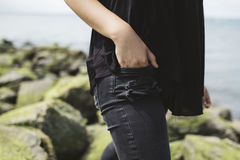 Person in Black Tops Wearing Black Denim Jeans Near Sea at Daytime Stock Photos