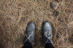 Person in Black Work Boots on Gray Hay Royalty Free Stock Photos