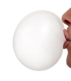 Person blowing a bubble Stock Images