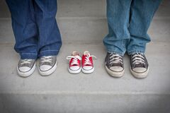 Person in Blue Denim Pants Wearing Gray and White Low Tops Stock Photo