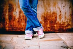 Person in Blue Jeans and Pink White Converse All Star Sneakers Stock Photos