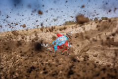 Person in Blue and Red Suit Riding Dirt Bike during Daytime Royalty Free Stock Image