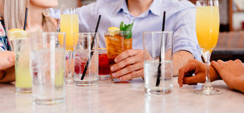 Person in Blue Shirt Near Clear Drinking Glass Stock Photos