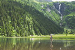 Person on Body of Water Fishing on Lake Stock Photo