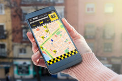 Person Booking Taxi On SmartPhone, through app Stock Photos