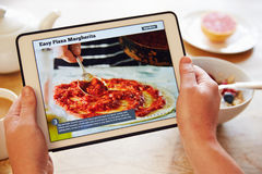 Person At Breakfast Looking At Recipe App On Digital Tablet Royalty Free Stock Photography