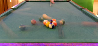 Person breaking on a pool table Royalty Free Stock Photo