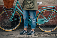 Person in Brown Jacket Standing Beside Bicycle Royalty Free Stock Images