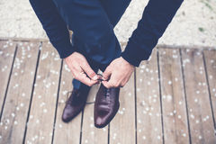 Person in Brown Leather Lace Shoes Tying Lace Royalty Free Stock Photography