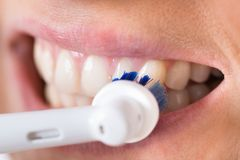 Person brushing teeth Stock Image