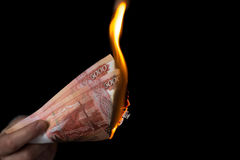 Person burns rubles horisontal Royalty Free Stock Photo