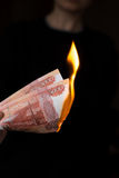 Person burns rubles Royalty Free Stock Photos