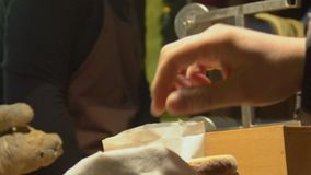 Person buying fresh hot pastry at celebration event, street food, slowmotion. Stock footage stock footage
