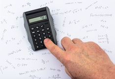 Person calculating on a pocket calculator Royalty Free Stock Image