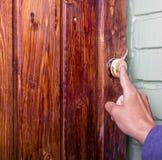 Person calls doorbell. Man calls his finger the old doorbell Stock Photography