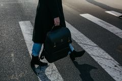 Person Carrying Bag Walking on Pedestrian Lane Stock Photography