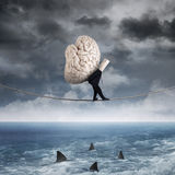 Person carrying a brain above sea Stock Photography