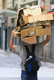 Person carrying cardboard Royalty Free Stock Photo