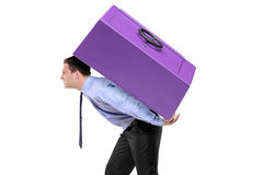 Person carrying a safe box on his back Stock Images