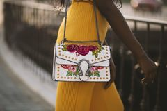 Person Carrying White and Red Floral Leather Crossbody Bag royalty free stock photo