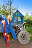 The person changes a wheel at the car Stock Image