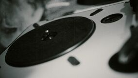 Person changing vinyl record on vintage player, retro style party, close-up stock video footage