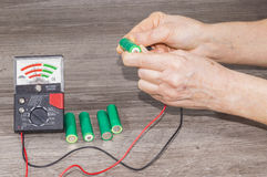 Person checking battery Stock Photos