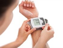 Person Checking Blood Pressure Imagens de Stock