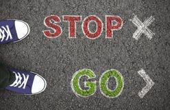 Person choosing between stop or go ahead