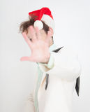 Person in Christmas cap closes face a hand Stock Photo