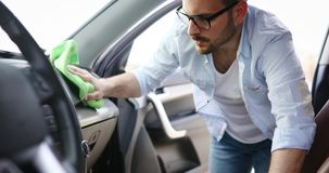 Person cleaning car with microfiber clot and maintaining shine. Person cleaning automobile with microfiber clot and maintaining shine Stock Photos