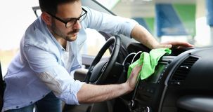 Person cleaning car with microfiber clot and maintaining shine. Person cleaning automobile with microfiber clot and maintaining shine Stock Image