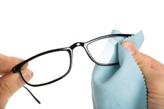 Person Cleaning Eyeglasses immagine stock