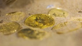 Person cleans coins belonging to encrypted bitcoin