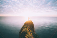Person on cliffs in ocean Royalty Free Stock Photo