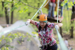 Person climbing at adventure park Stock Image