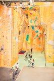 Person climbing on artificial climbing wall, Australia. Royalty Free Stock Photos