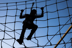 Person climbing on high ropes. One Person climbing on high ropes Stock Photos