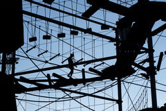 Person climbing on high ropes. One Person climbing on high ropes Royalty Free Stock Photos