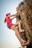 Person climbing a rock royalty free stock images